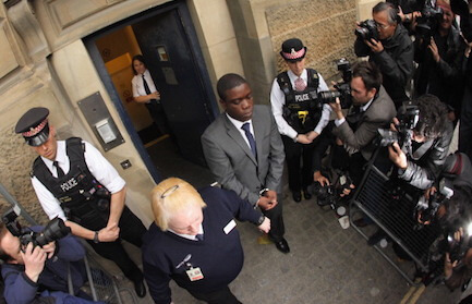 LONDON, ENGLAND - SEPTEMBER 22: Kweku Adoboli (C), a trader for the Swiss investment bank UBS leaves the City of London Magistrates Court on September 22, 2011 in London, England. Mr Adoboli is alleged to have made unauthorised trades that resulted in losses to UBS of 1.5 billion GBP. (Photo by Oli Scarff/Getty Images)